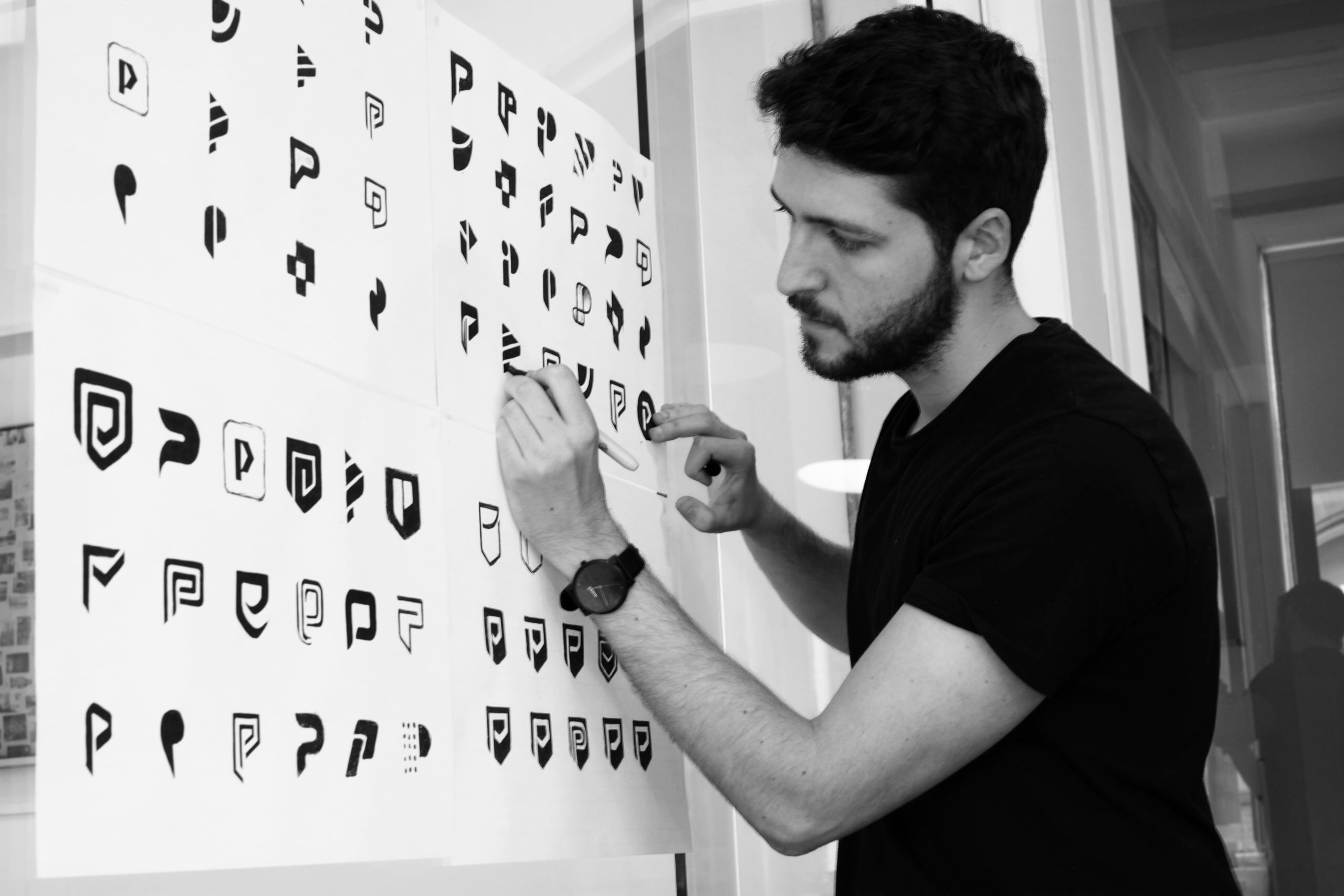 Designer Interview With Emanuele Ricci - Logo Design Process